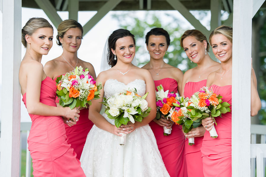 bride and bridesmaids group photo under gazebo in in fort totten queens ny