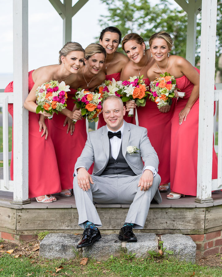 groom and bridesmaids in gazebo in in fort totten queens ny