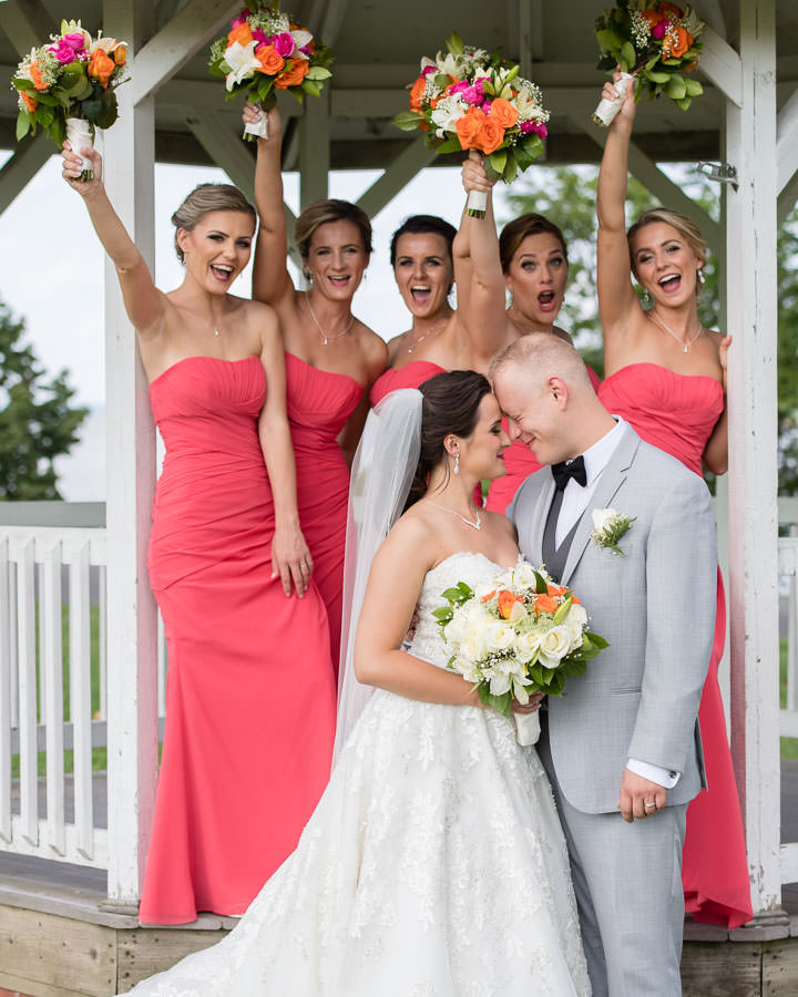 bride and groom with bridal party cheering in in fort totten queens ny