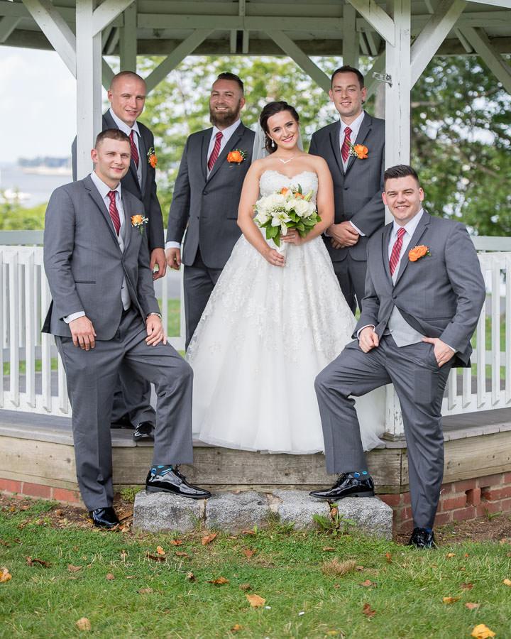 bride and groomsmen under gazebo in in fort totten queens ny