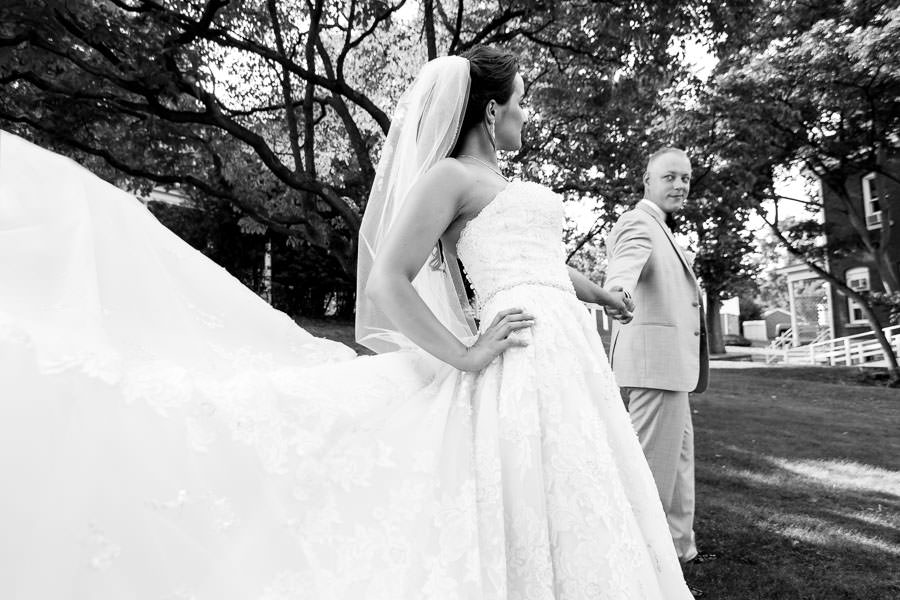 amazing pose with bride and groom with david's bridal gown close to camera