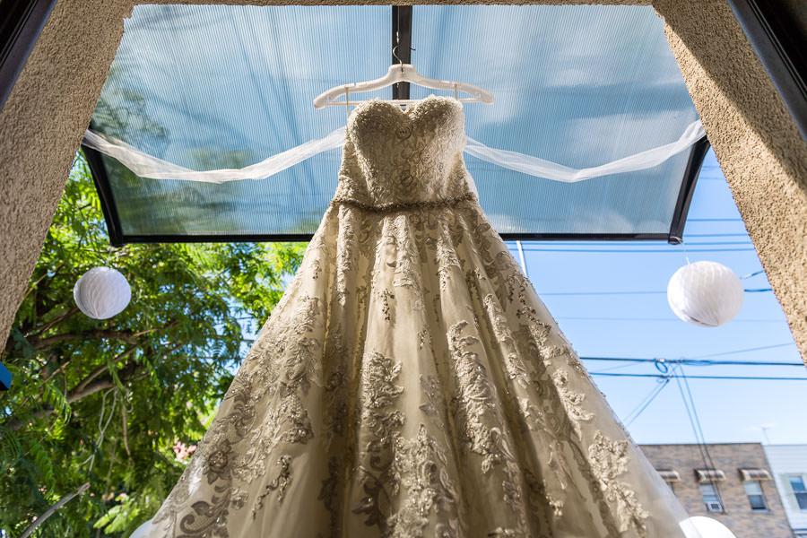 david's bridal dress hanging outside home detail photo
