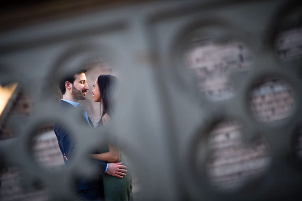 engagement couple in central park girl in green romper guy in suit by bethesda terrace artistic photo