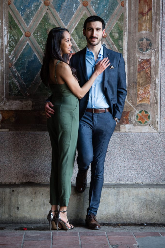 engagement couple in central park girl under bethesda terrace