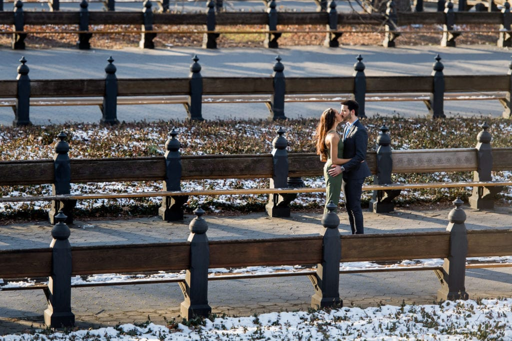 engagement couple in central park by the mall girl in green romper