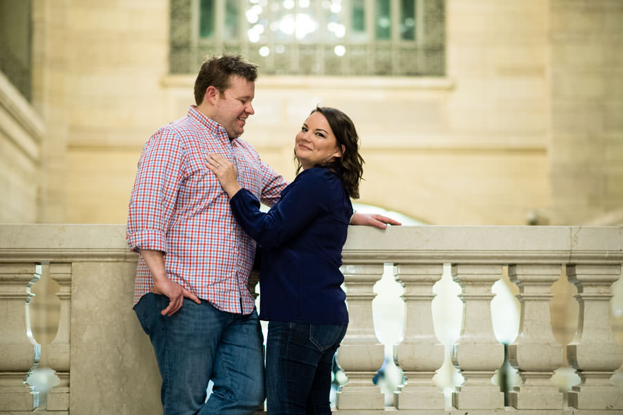 couple engagement session in grand central station in new york city guy holding his fiance
