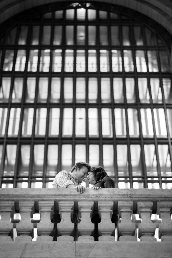 couple engagement session in grand central station in new york city creative angle