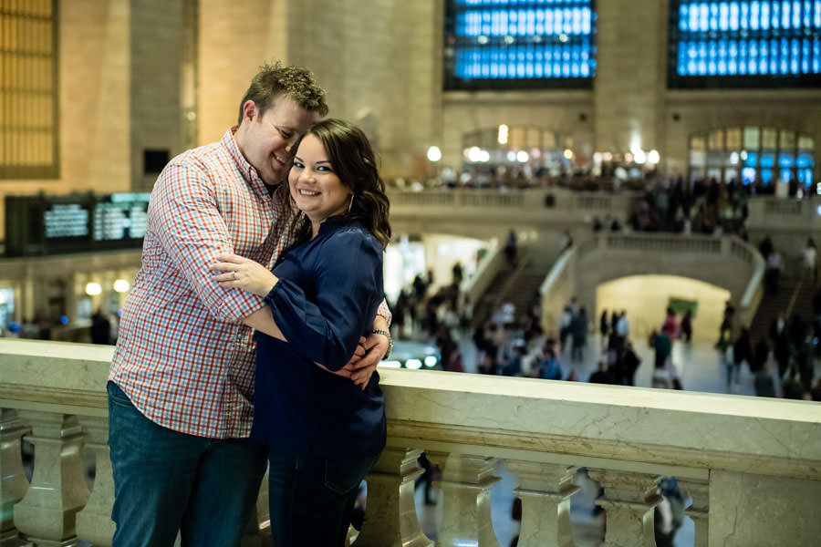 couple engagement session in grand central station in new york city couple cuddling