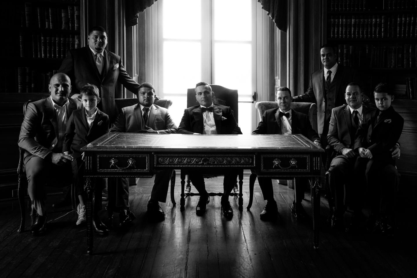 Groom and groomsmen group photo at oheka castle library in long island wedding venue new york