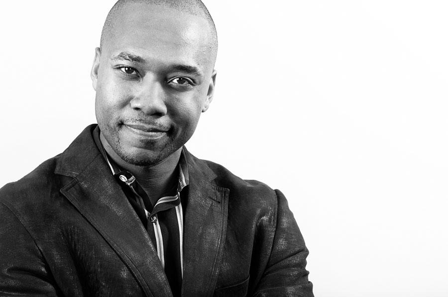 professional studio headshot black man white background
