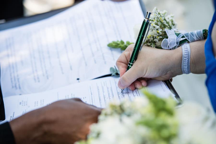 bride signing wedding contract