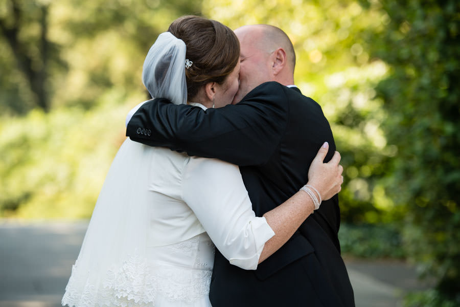 bride and groom kissing at wedding ceremony in brooklyn botanic garden in nyc