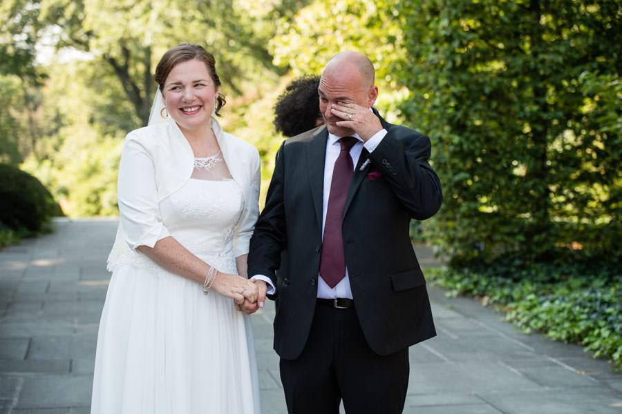 groom crying at wedding ceremony in brooklyn botanic garden in nyc