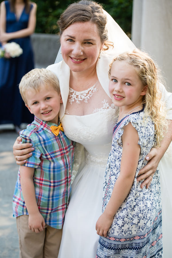 bride and family after wedding ceremony with children