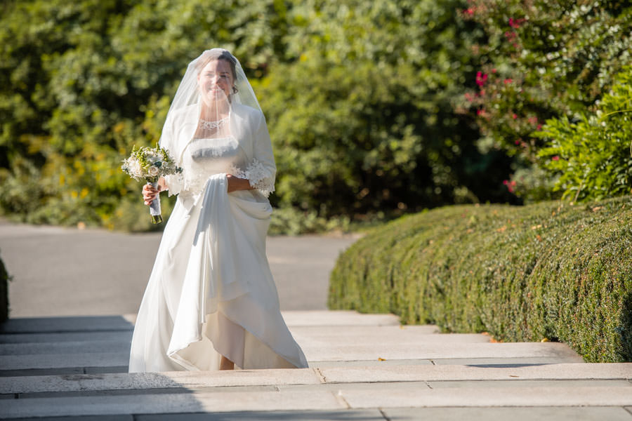 bride walking down aisle during procession at wedding in brooklyn botanic garden in nyc