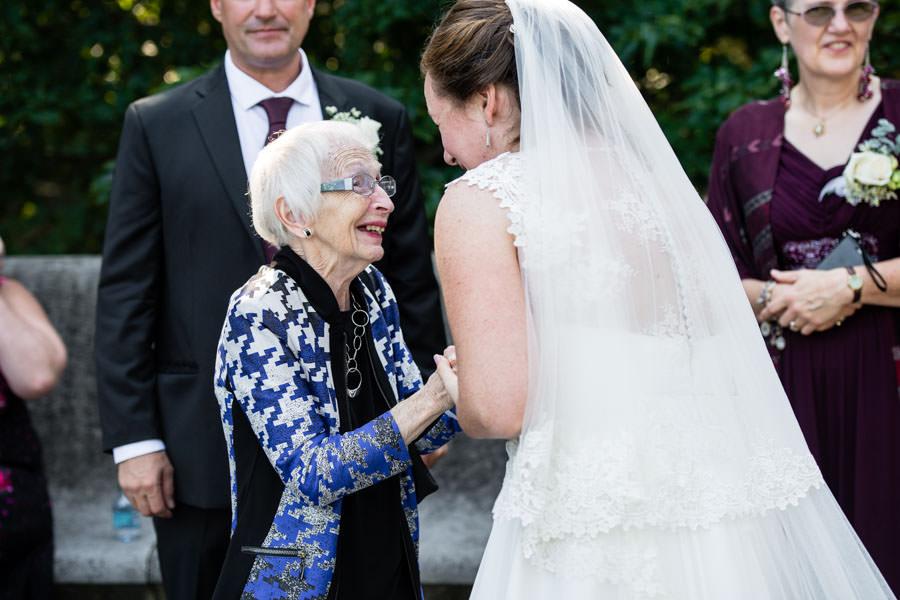 bride with grandma happy after wedding ceremony