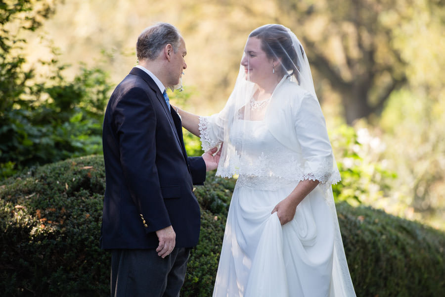 bride with father at wedding in brooklyn botanic garden in nyc