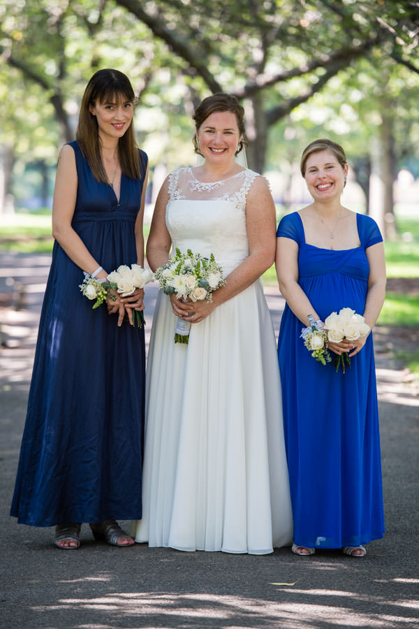 bride and her bridesmaids in brooklyn botanical gardens in nyc