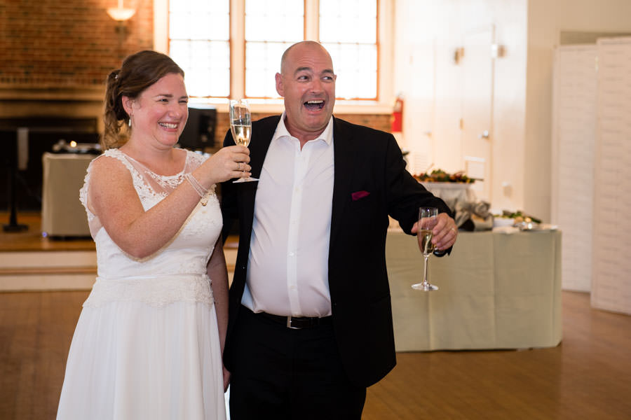 bride and groom giving toast at picnic house in prospect park