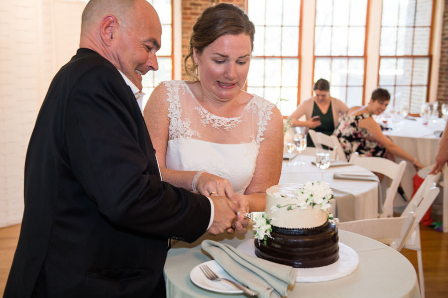 bride and groom cutting cake at picnic house in prospect park