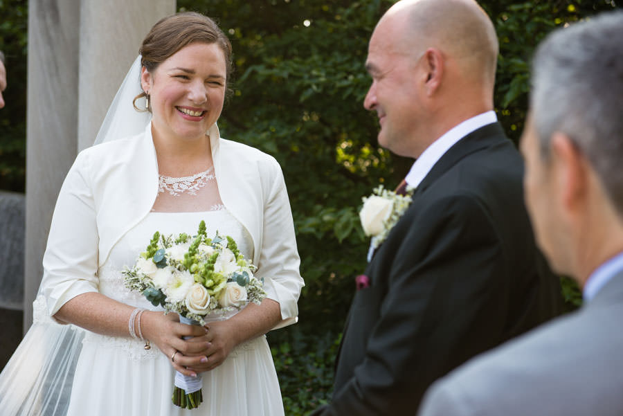 bride and groom at wedding ceremony in brooklyn botanic garden in nyc