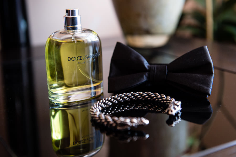 Groom's bow tie and cologne detail shots on wedding day