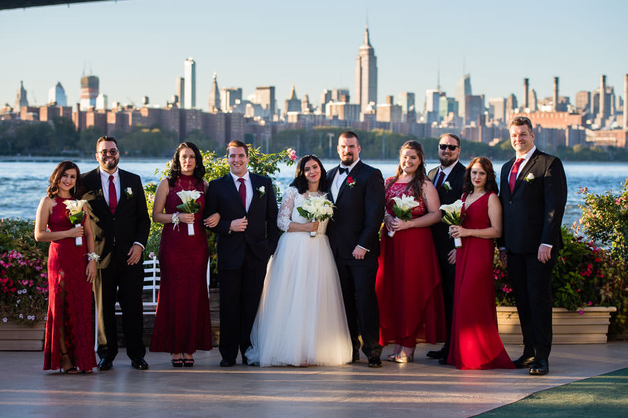 Bridal party with NYC skyline in the background at wedding at Giando on the water in Brooklyn, NY