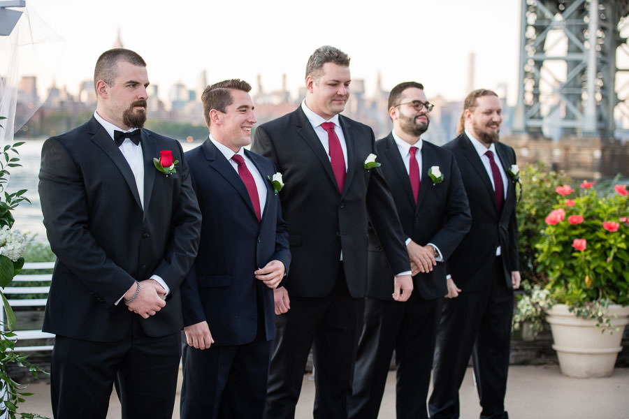 groomsmen during ceremony at wedding at Giando on the water in Brooklyn, NY