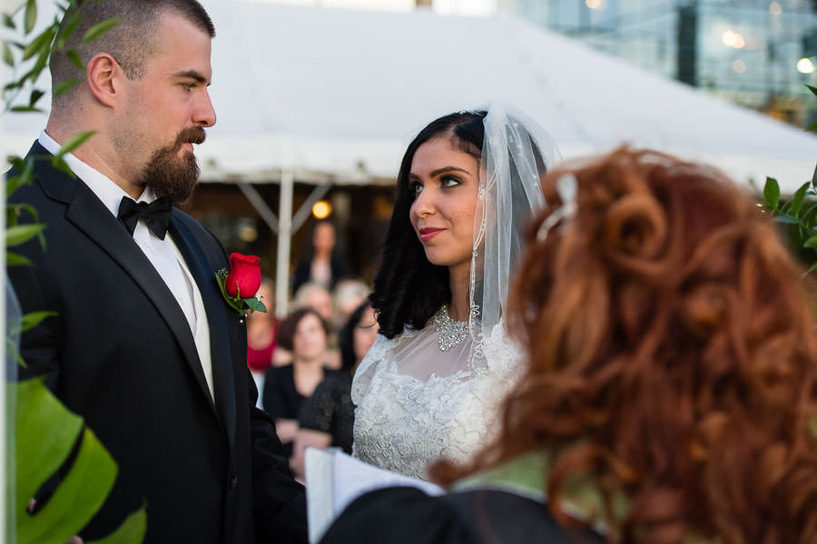 bride looking at her groom during wedding ceremony