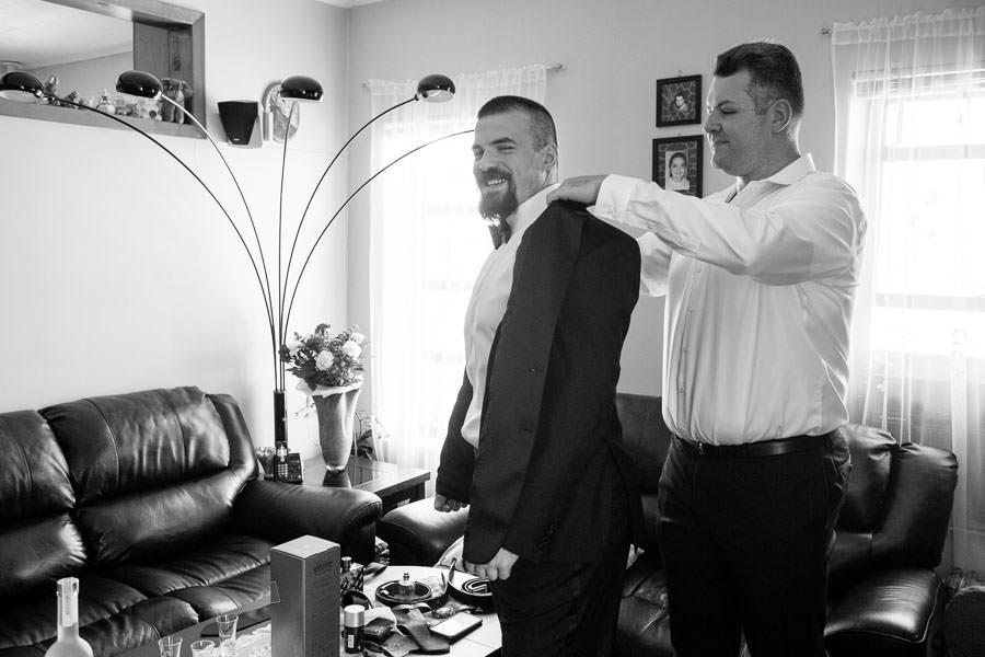 groom getting dressed during groom prep in brooklyn, ny
