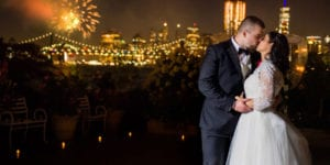 wedding at Giando on the Water Restaurant in Brooklyn with NYC skyline and fireworks in the background at night
