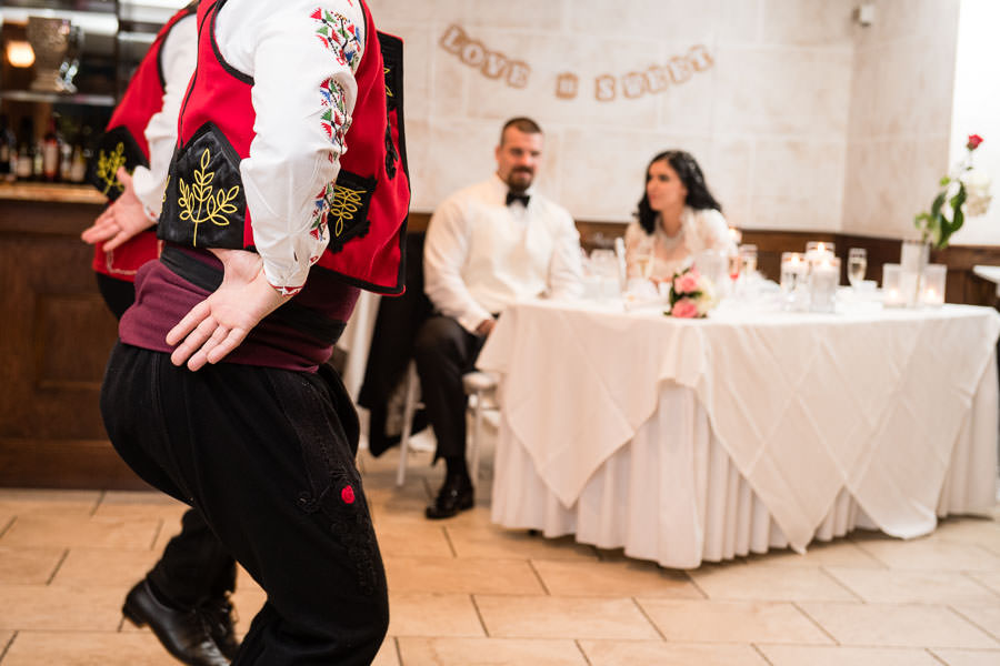 Bulgarian Folk Dancing group performing at Giando on the Water with bride and groom watching