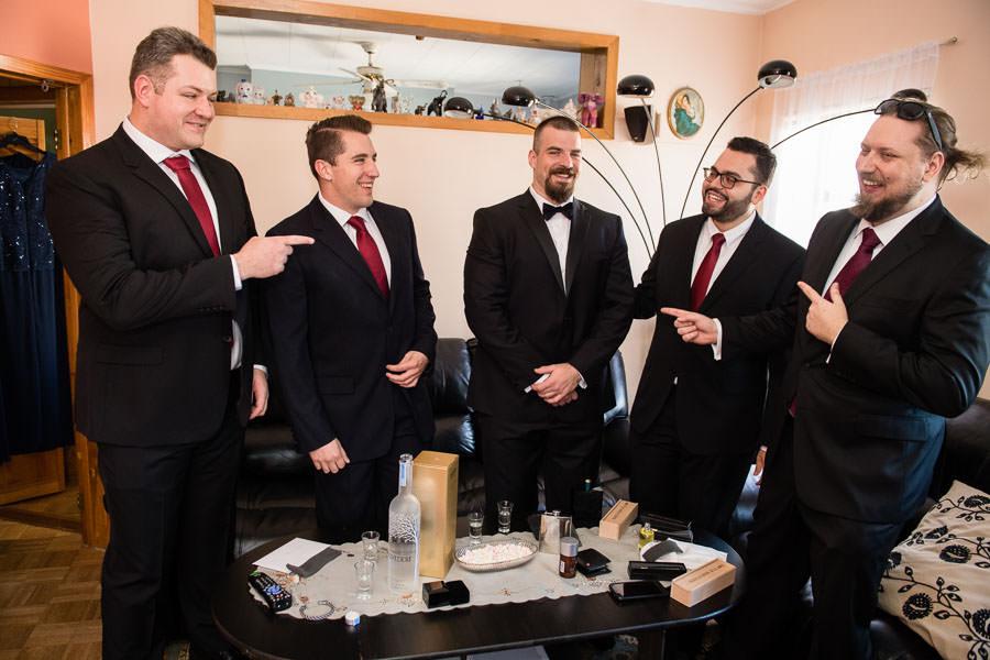 groomsmen laughing Bottle breacher gifts for groomsmen at brooklyn wedding