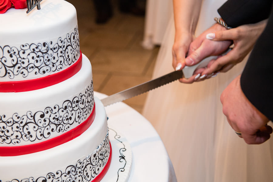 couple cutting wedding cake in Brooklyn, NY