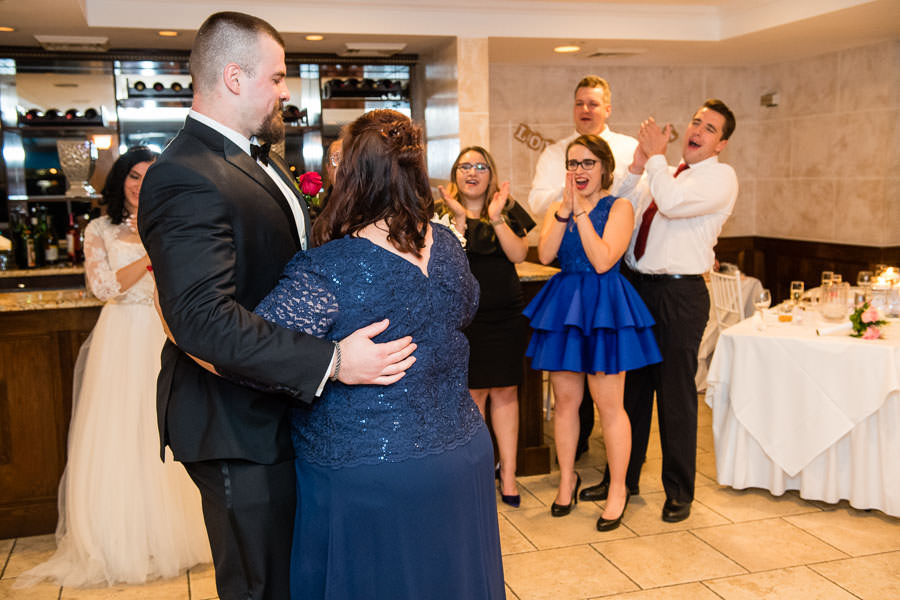 groom dances with his mother at wedding in giando on the water