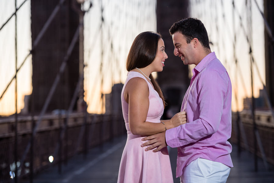 close up of guy and girl laughing on brooklyn bridge in nyc