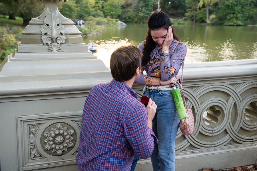 girl crying during marriage proposal on bow bridge in central park