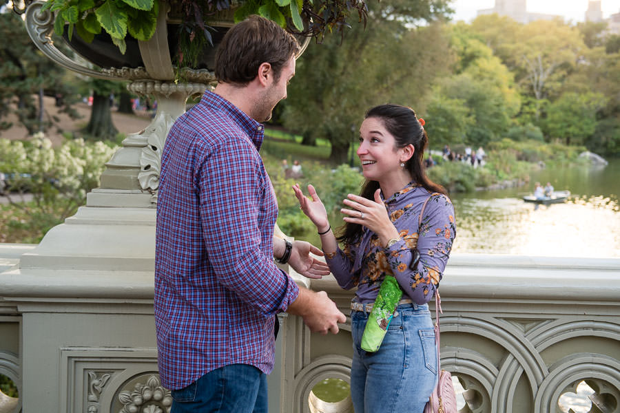 girl is very happy and excited after proposal in central park