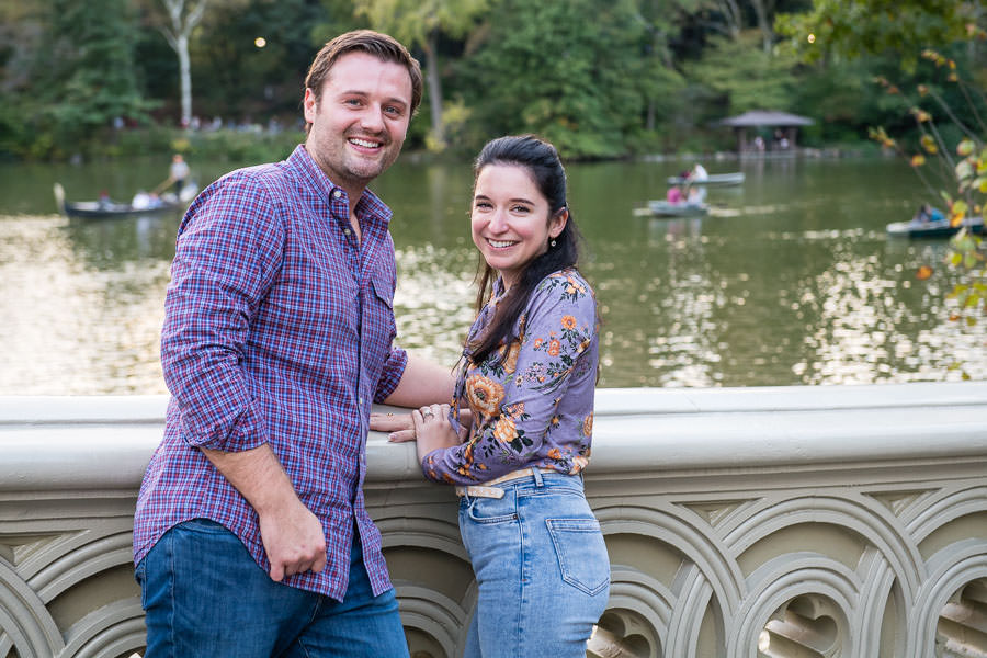 man and girl smile next to loeb boathouse in central park after marriage proposal