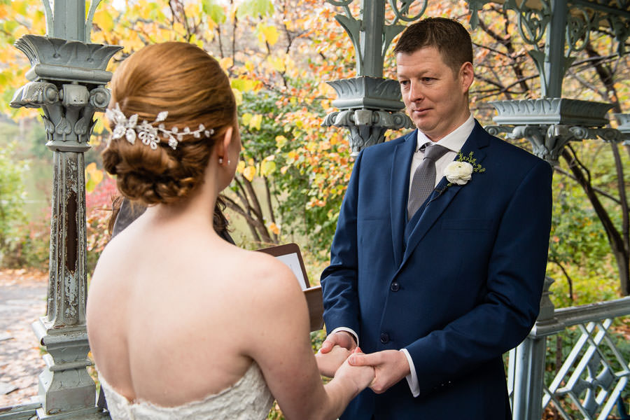 groom looks at his bride during central park wedding