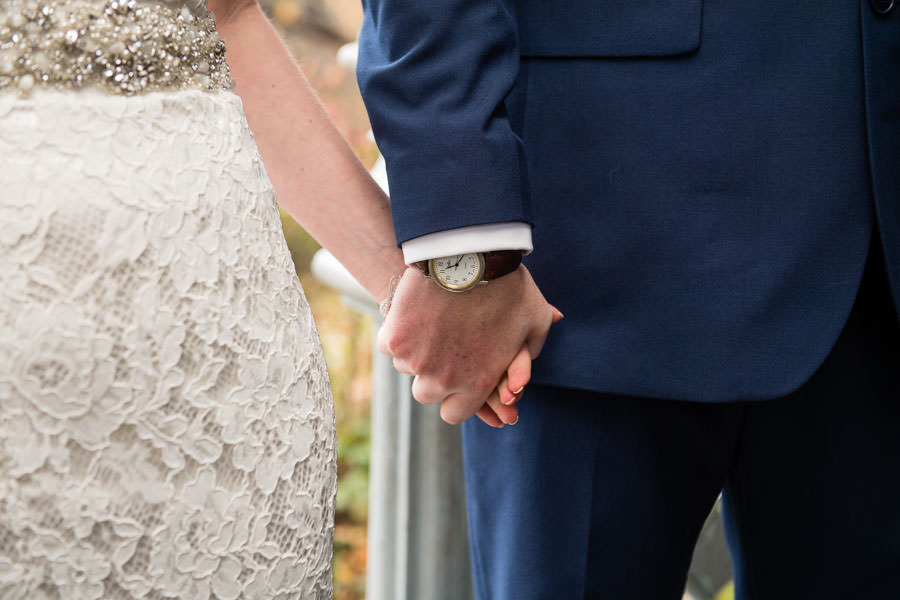 bride and groom hold hands after saying i do
