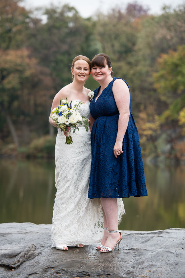 bride and her maid of honor in central park in the fall