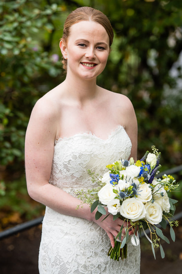 portrait of bride with her bridal bouquet in central park