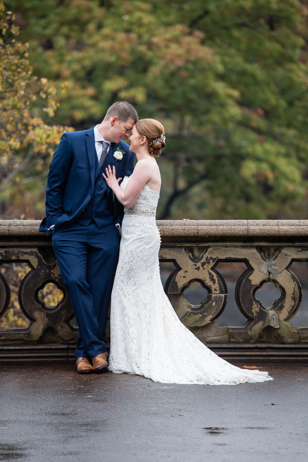 bride and groom touch foreheads together and are happy after their wedding in central park