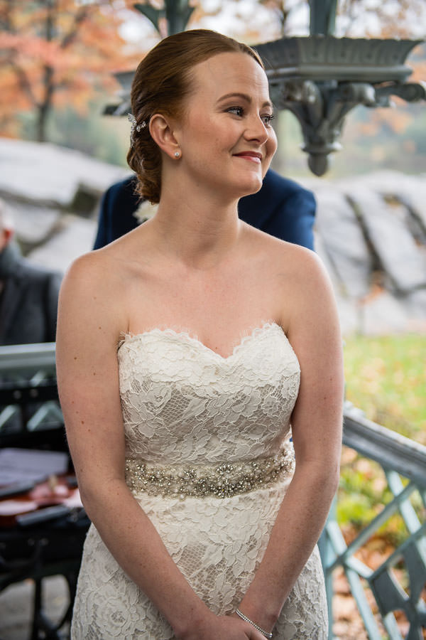 bride is happy as she looks at her groom at ladies pavilion in central park in nyc
