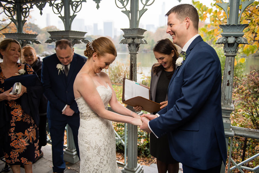 bride and groom laugh during elopement in ladies pavilion in central park