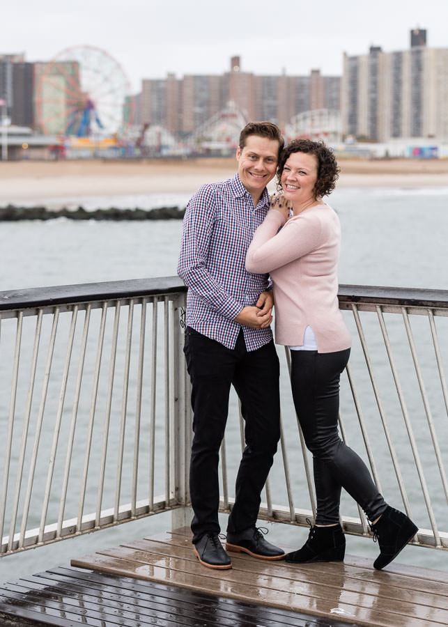 coney island engagement session with ferris wheel in the background