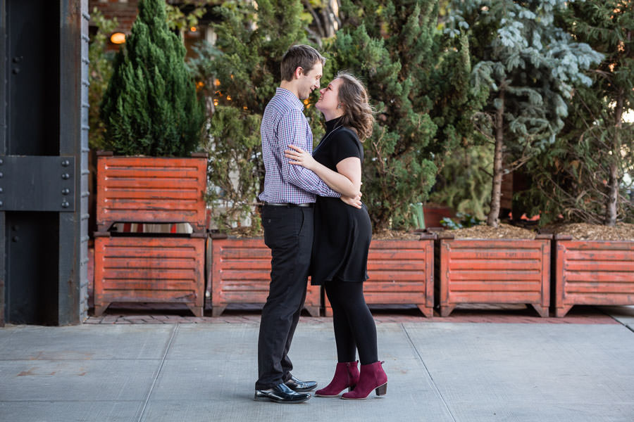 engaged couple hold each other in fall engagement session in nyc