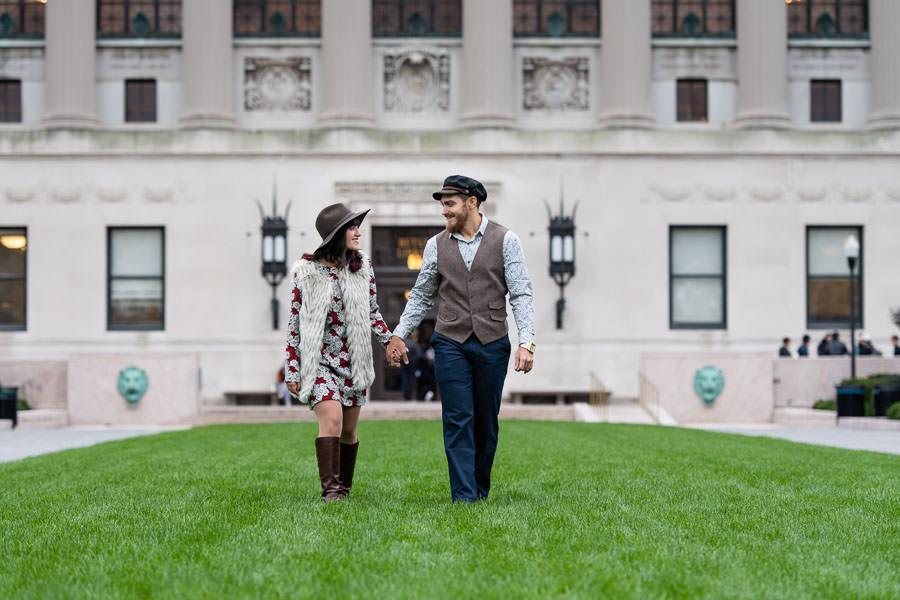couple walks along the lawn at Columbia University in NYC