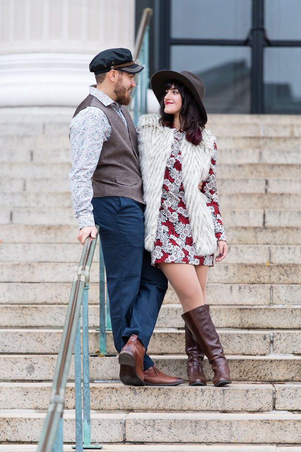 couple stand on steps at columbia university engagement session